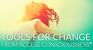 A HAPPY WOMAN ENJOYING the Access Consciousness tools to change her life